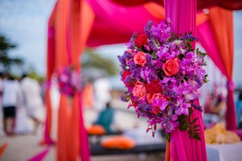 Photo of Bright purple and pink floral decor for a wedding function