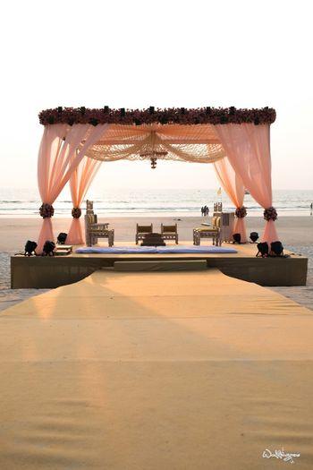 Beach mandap idea in pastel pink