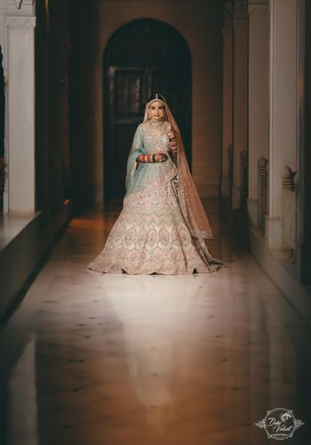 An elegant bride in a beautiful pastel lehenga on her wedding day.