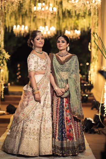 Photo of sister of the bride or bridesmaids in fancy lehengas