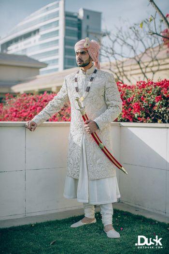 Photo of white layered self work sherwani