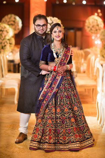 Photo of Embroidered reception lehenga in dark blue