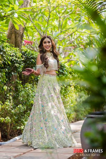Happy bride shot in light green lehenga on mehendi