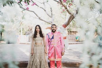 Bride and groom in gold and pink