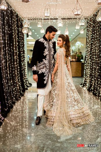 A bride and groom in coordinated clothes for their sangeet ceremony