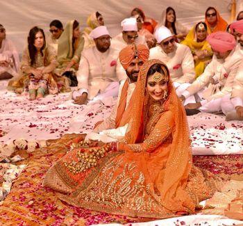 Photo of Sikh Couple Shot - Orange Sabyasachi Lehenga