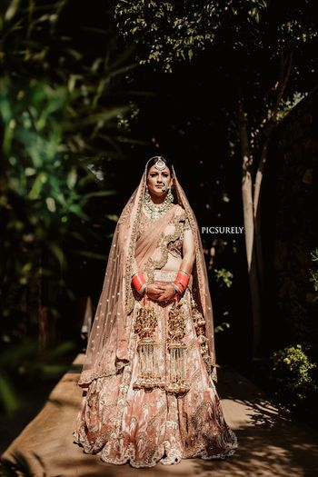 Photo of Offbeat dusty peach bridal lehenga by Gazal Gupta
