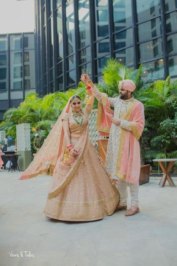 Matching bride and groom in peach outfits