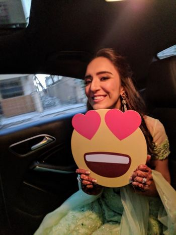 Photo of Happy bride holding smiley prop