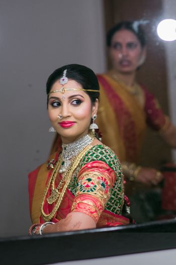 South Indian Bride Wearing Green and Pink Saree