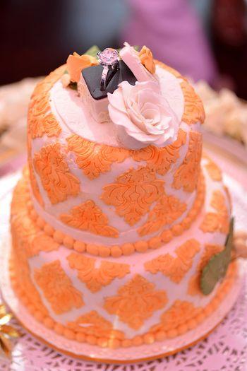 Photo of mango yellow and white cake