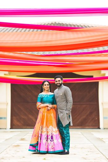 Mehendi couple colourful portrait with drapes
