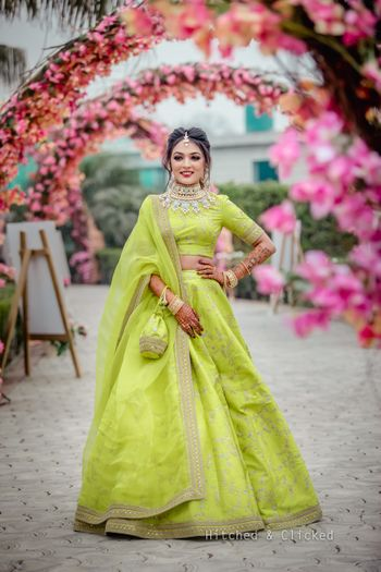 Photo of Mehendi bridal look in lime green lehenga