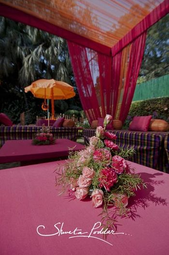 Photo of pink and orange cushions pink and orange drapes pink and orange theme