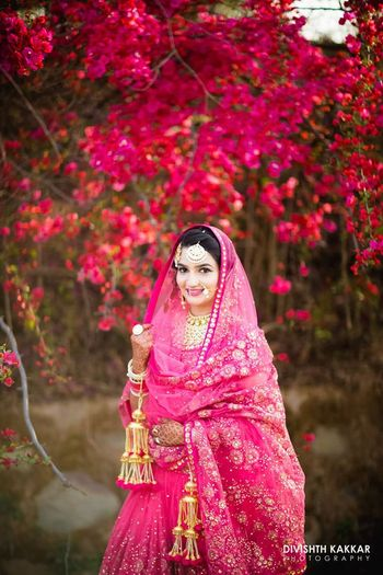 Photo of Sikh bride in hot pink