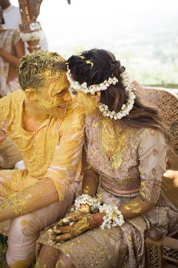 Photo of Bride and groom cute haldi portrait