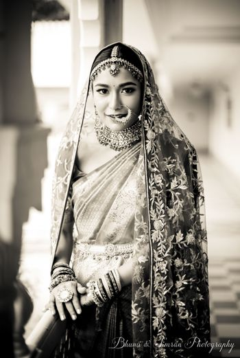 Bride with saree and dupatta on wedding day black and white photo
