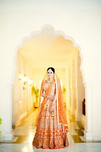 Photo of Orange and gold bridal lehenga for bride