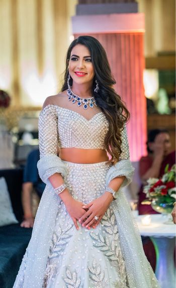 Photo of Pretty off shoulder blouse with silver lehenga