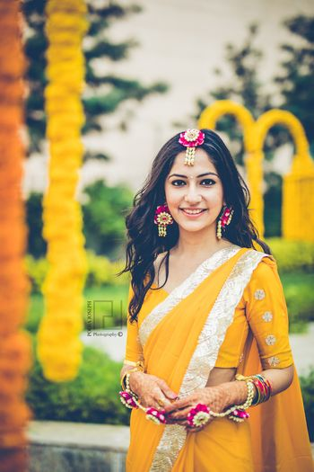 Photo of Bride wearing floral jewellery on haldi