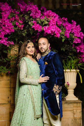 Sangeet couple shot with bride in pista green lehenga