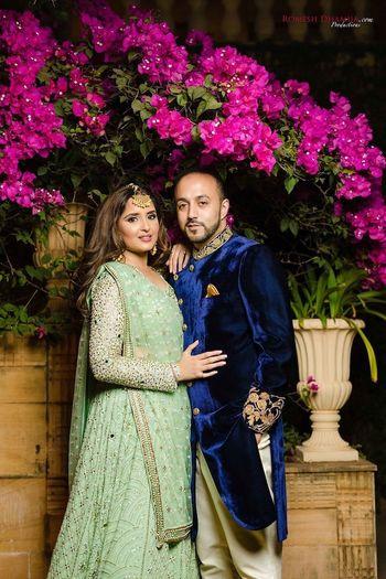 Photo of Sangeet couple shot with bride in pista green lehenga