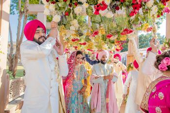bride and groom entering under phoolon ki chadar