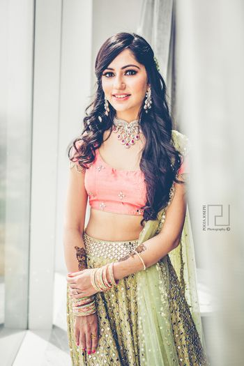 Photo of Sage green and peach lehenga for mehendi