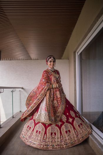 Photo of pretty bridal lehenga shot with unique embroidery