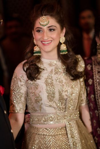 Photo of Sangeet lehenga with gold waist belt