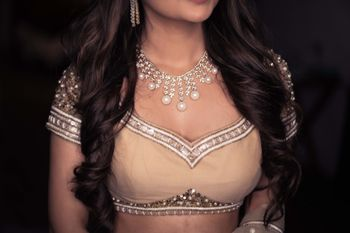 Photo of bridal blouse with pearl and diamond necklace