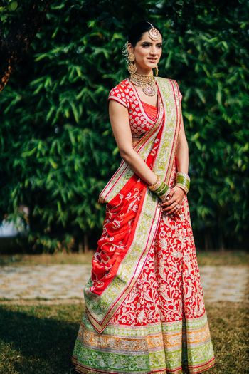 Photo of A beautiful bridal portrait capturing the bridal lehenga