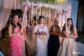 Photo of Bride entering under phoolon ki chadar