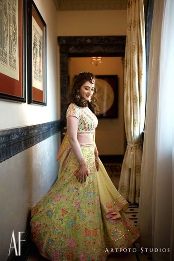 Yellow mehendi lehenga with floral work