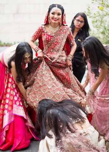 A bride in a goofy moment with her bridesmaids