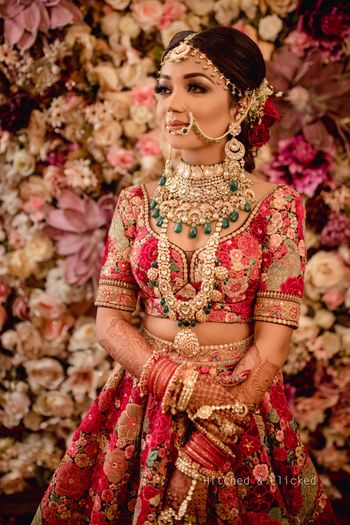 Photo of Bridal portrait with layered jewellery and sabyasachi lehenga