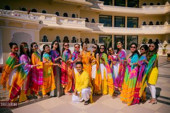 Groom with bridesmaids wearing leheriya dupattas