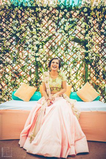 Happy bride in pastel lehenga