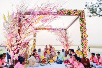 Floral mandap decor idea for beach wedding