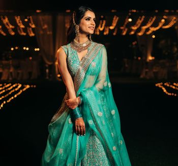 Bride in a gorgeous blue lehenga for sangeet