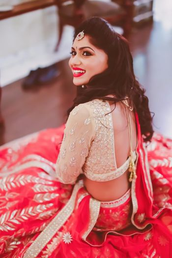 Photo of light gold and red lehenga
