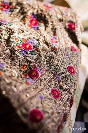 Photo of royal gold bridal lehenga with threadwork and zardozi
