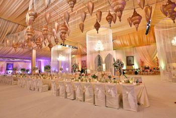 Photo of white and gold wedding decor