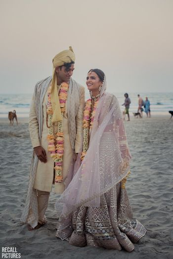Photo of Beach wedding couple shot with lilac lehenga
