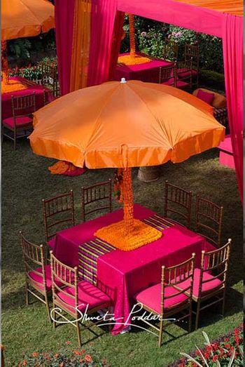 Photo of orange umbrella with genda flowers