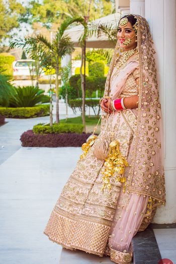 Sikh Bride in Pastel Pink and Gold Lehenga and Jewelry
