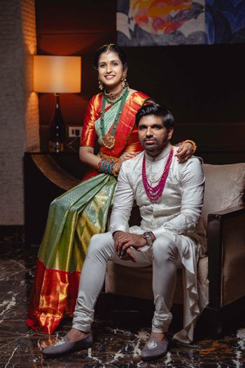 south indian couple shot with bride in green and rust kanjivaram