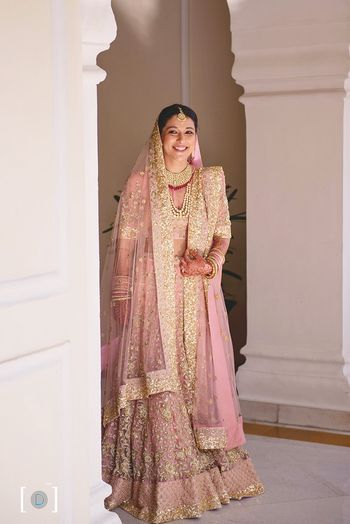 Bride in light pink and gold sequin work lehenga