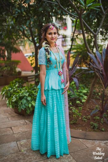 Photo of Turquoise peplum lehenga for bride on mehendi