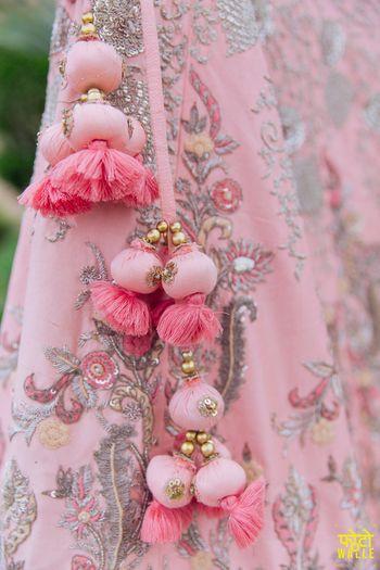 Light pink lehenga with tassels